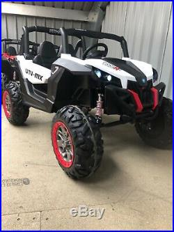 Kids ride on 12 volt buggy, 4 wheel drive, MP4 player, LED lights, rubber tyres
